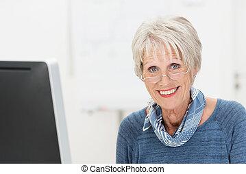 Attractive trendy senior businesswoman
