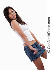 Attractive twenties asian fashionable woman in jeanskirt