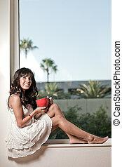 Attractive twenties hispanic brunette woman relaxing...