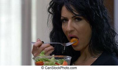 Attractive unhappy woman dislike eating vegetarian healthy...