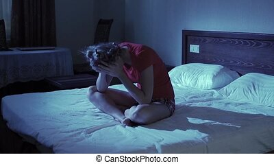 Attractive unhappy young woman in bed