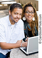 attractive uni students - two attractive african american...