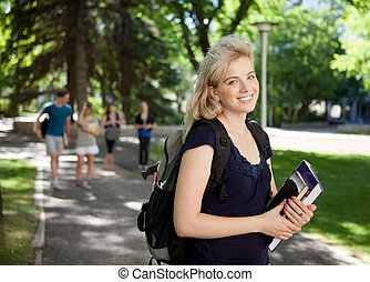 Attractive University Student - Portrait of a happy...