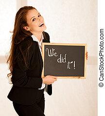 attractive university student with blackboard