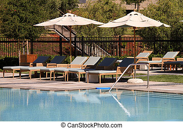 Attractive upscale pool and deck for the avid reader