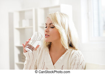 Attractive well-being girl drinking water in the morning.
