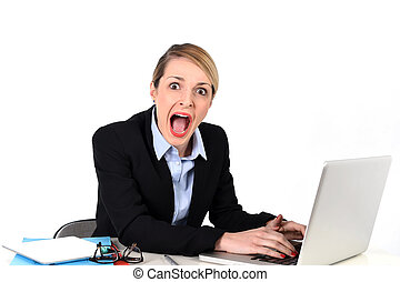 businesswoman sitting at office desk working with laptop in ...