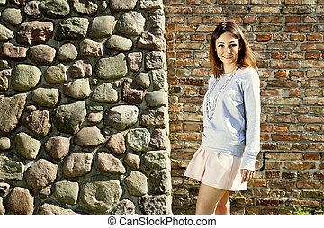 Attractive woman against wall
