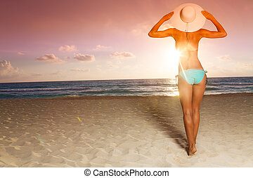 Attractive woman and beach