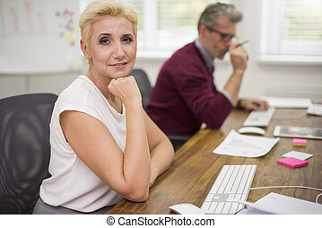Attractive woman and her co worker at work