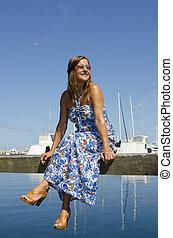Attractive woman at marina
