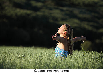 Attractive woman breathing joyful