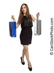 Attractive woman carrying shopping bags
