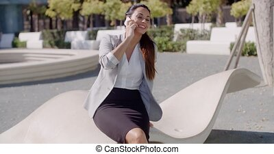Attractive woman chatting on her mobile outdoors