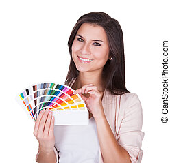 Attractive woman chooses a color scheme. Studio portrait...
