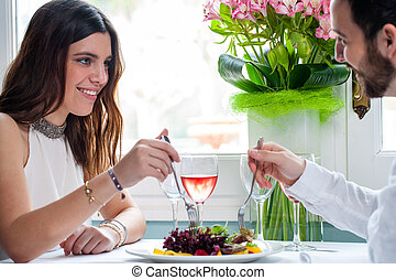 Attractive woman dining with boyfriend. - Close up portrait...