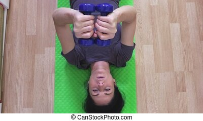 Attractive woman doing exercises at home