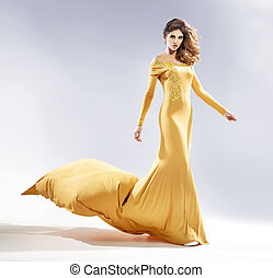 Attractive woman dressed in a evening gown - Attractive...