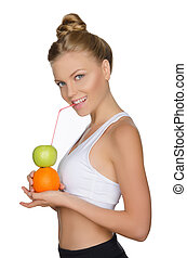 attractive woman drinking juice from fruits