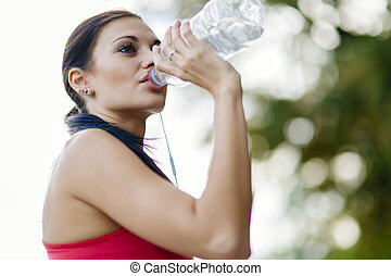 Attractive woman drinking water