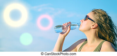 Attractive woman drinking water.