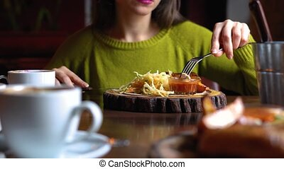 Attractive woman eating lunch in cafe - Attractive young...
