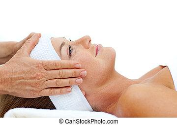 Attractive woman enjoying a head massage