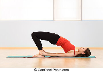 Attractive woman exercising in aerobics class. Young beautiful fitness girl exercising in gym