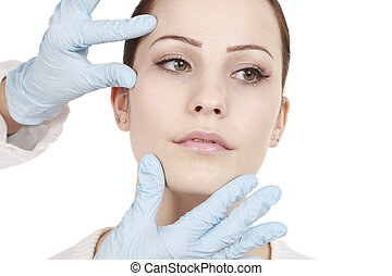 Attractive woman gets beauty treatment by a doctor