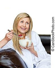 Attractive woman having a breakfast