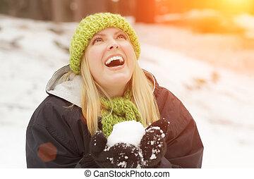 Attractive Woman Having Fun in the Snow