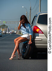 Attractive woman having problem with her car