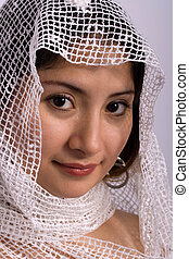 Attractive woman, head covered with white scarf
