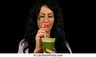 Attractive woman healthy drinking and enjoying a green...
