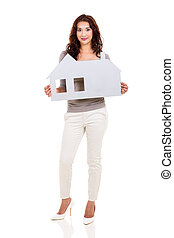 woman holding a paper house