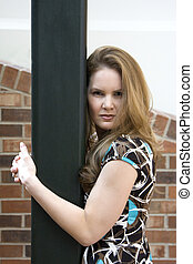 Attractive Woman Holding Post