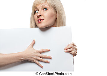 Attractive woman holding white empty paper isolated on white