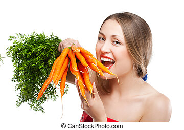 attractive woman holds bunch of carrots - attractive woman...