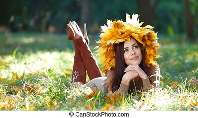 Attractive Woman in Autumn Wreath