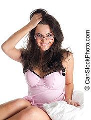 Attractive woman in bedroom