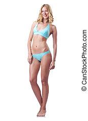 Attractive woman in bikini on white