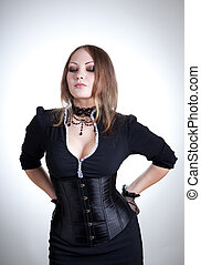Attractive woman in black dress and corset