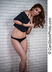 Attractive woman in black shirt. Studio shot