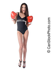 Attractive woman in boxing gloves shouts