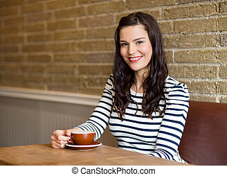 Attractive Woman in Cafe with Coffee