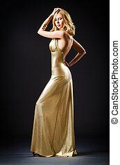 Attractive woman in dark room