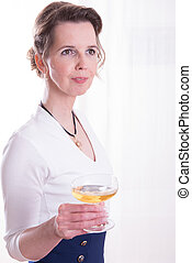 attractive woman in evening outfit with glass of champagne