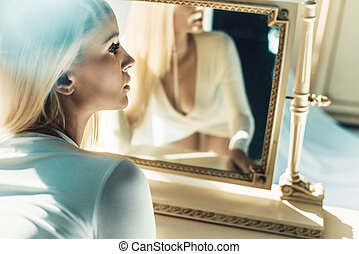 Attractive woman in front of the mirror