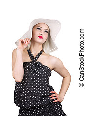 Attractive woman in hat and dotted dress