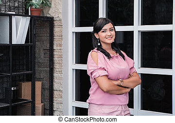 attractive woman in her creative office smiling